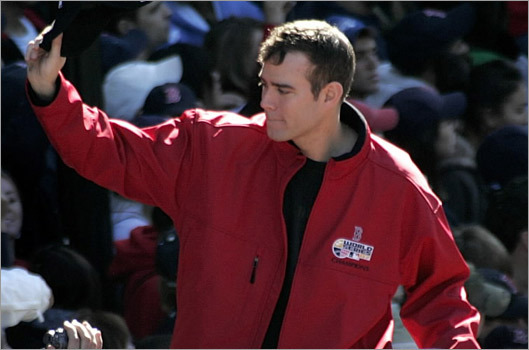 Sox General Manager Theo Epstein is seen waving to the crowd at a Hub parade celebrating the team's World Series victory in October.
