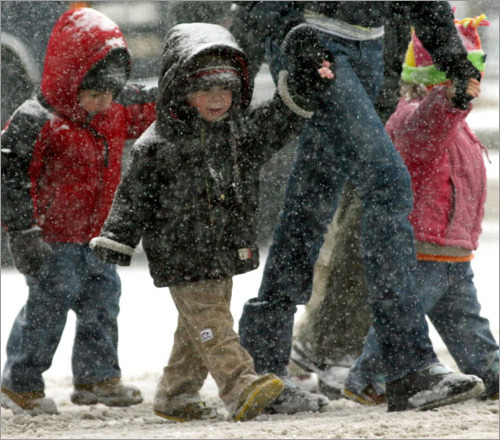 Some schools shut their doors early as the snowstorm started. Many children enjoyed the swirl of white flakes about them as they headed back home.