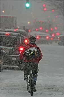 A lone biker braved the storm, weaving through the stopped cars on Massachusetts Avenue.