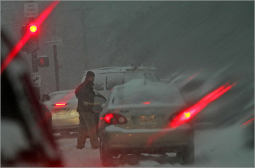 Traffic was so clogged in Watertown that a driver had time to get out of his car and clean his windows.