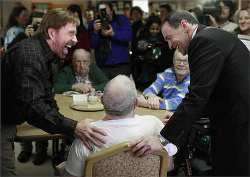 Actor Chuck Norris (left) traveled with presidential candidate Mike Huckabee (right) and spent some time at the New Hampshire Veterans Home in Tilton, N.H., on Dec. 14.
