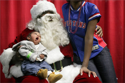 Davan Johnson (right) and her 2-month-old daughter Saniya Johnson (left) posed for a picture with Santa Claus during the Christmas in the City celebration on Dec. 16.