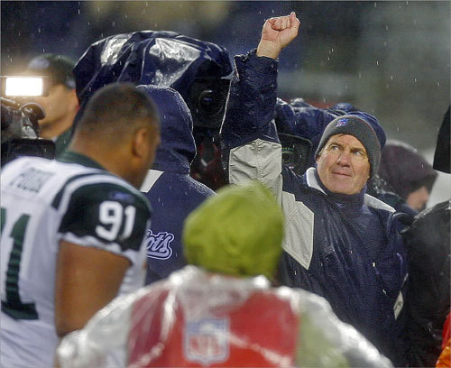 New England Patriots head coach Bill Belichick pumped his fist in victory as he left the field, celebrating his team's 20-10 victory over the New York Jets on Dec. 16. Inclement weather could not stop the Patriots as they improved to 14-0 and defeated former defensive coordinator Eric Mangini and his Jets for the second time this season.