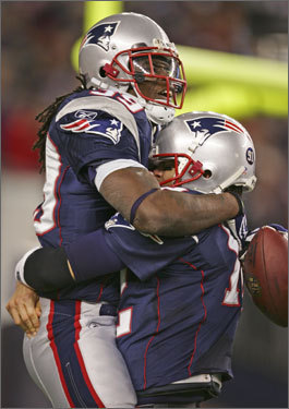 Laurence Maroney was lifted by teammate Tom Brady after Maroney's 59-yard touchdown run.