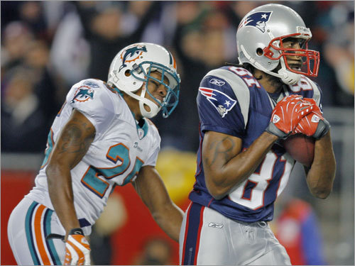 Patriots wide receiver Randy Moss (81) left Dolphins cornerback Will Allen looking a bit upset after he hauled in his second touchdown pass of the game.