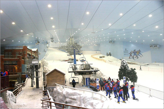 People queue for a ski lift at the Ski Dubai Park in Dubai. The facility is the third largest indoor slope in the world, holding over 6,000 tonnes of snow and can accommodate around 1,500 people.