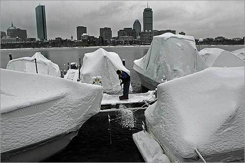Charles River Yacht Club member Tom Stack removed snow from the docks on Memorial Drive in Cambridge.