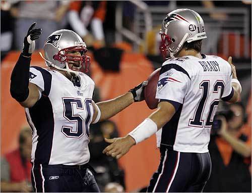 Purring along Maroney sits with a groin injury, so in steps Sammy Morris to rumble for 117 yards and a touchdown to nicely complement the now oh-so -predictable passing game -- Brady three more TD passes, Moss two more TD catches and another 100+ yards, and an old favorite, LB Mike Vrabel stepping in at tight end near the goal line and catching a TD pass. Game recap | Photos
