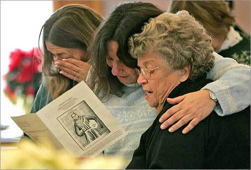 At Trinity Congregational Church in Gloucester, (from left) Pattie Barry, Mary Ellen Whitney, and Arlene Durkee sang during a service of community support just across the street from the scene of an eight-alarm fire that killed resident Robert Taylor and destroyed an apartment building and synagogue. Whitney, who lived in the building, and Durkee were friends of Taylor.