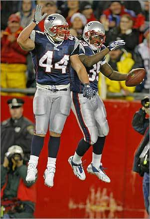 Fullback Heath Evans (left) and running back Laurence Maroney leaped into the air in celebration of Maroney's second quarter 59-yard touchdown run, giving New England a 21-0 lead.