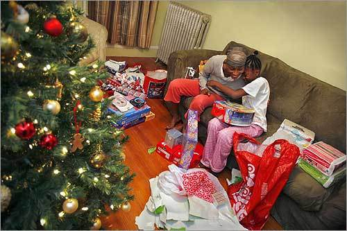 Kendra Jackson got a hug from her daughter, Toni Harris, 11, as they opened presents on Christmas morning.