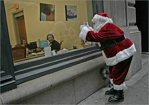 Tom Dicorcia of Natick has been dressing up as Santa for 20 years, volunteering for different children's agencies. While walking down Devonshire Street in Boston, he caught the attention of some office workers.