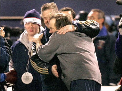 Former Patriots assistant coach Charlie Weis (left) and Bill Belichick (right) embraced as the clock ran out and the Patriots won the game.
