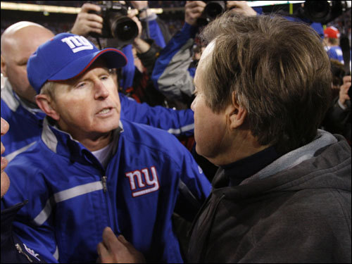Giants coach Tom Coughlin (left) and Patriots coach Bill Belichick shook hands after the game.