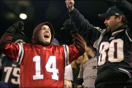 Patriots fans celebrated their team's perfect regular season at Giants Stadium.
