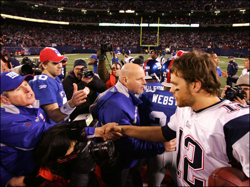 Tom Brady (right) shook hands with Giants head coach Tom Coughlin (left) and Eli Manning (10) after the game.