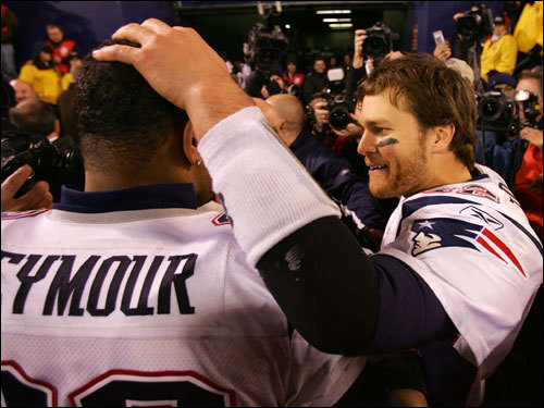 Richard Seymour (left) celebrated with Tom Brady (right) after the game.
