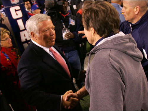 Patriots owner Bob Kraft (left) congratulated Bill Belichick (right) on a perfect regular season.