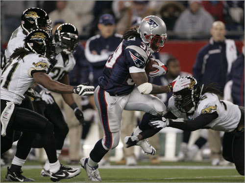 Tom Brady completed his first 16 passes and was 26-of-28 passing for 262 yards and three touchdowns, while Laurence Maroney (left) rushed for 122 yards on 22 carries as the offensive propelled the Patriots past the Jacksonville Jaguars in an AFC divisional playoff game at Gillette Stadium.