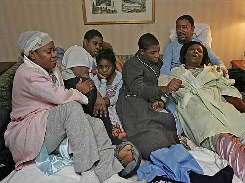 The Zizi family (from left), Guelie, 23, Samuel, 16, Berlinda, 7, Shinaider, 14, and parents Mona and Gary, sat at the Best Western Motel a day after after their two siblings, Rebecca, 9, and Rooben, 11, died in a fire at their Dorchester home.
