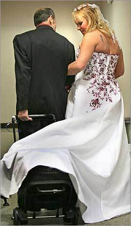 Serge Carrier, with artificial heart pump in tow, and bride Nicole Gobeil reentered the reception room at Tufts New England Medical Center, where the couple celebrated their marriage with friends and family.