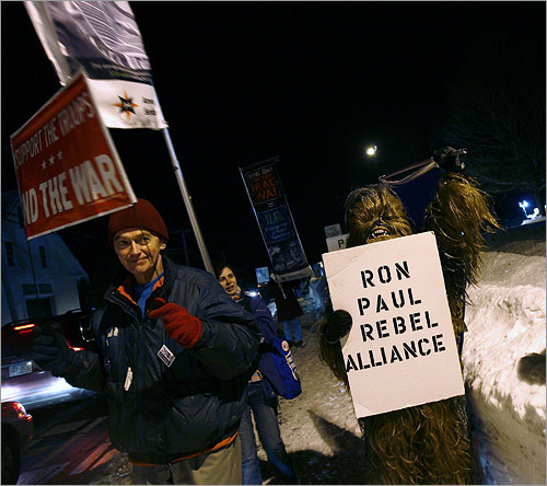 A Ron Paul supporter, dressed as Chewbacca from Star Wars, stumped for the Texas congressman outside the college.