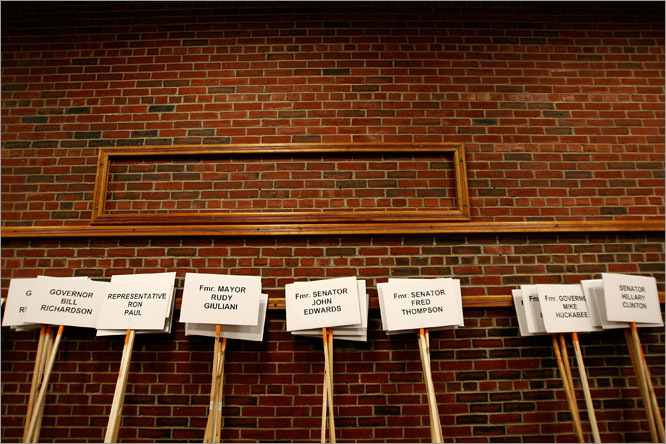Signs of the candidates were placed on a brick wall in St. Anselm College in New Hampshire before the debate.