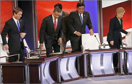 Left to right, John Edwards, Barack Obama, Bill Richardson, and Hillary Clinton took their seats for the debate. The candidates quickly divided into two groups, with Clinton and Richardson repeatedly stressing their experience, and Edwards and Obama promising to bring change to Washington.