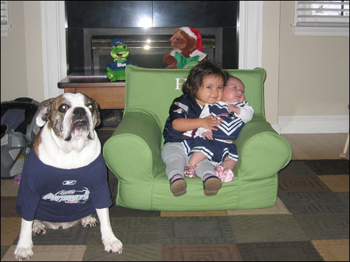 Riley and Haley of Andover get ready to cheer on the Pats with bulldog Paris in tow.