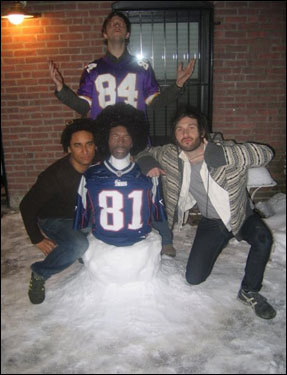 Chris Fore, Ben Jallow, and Alex Maniatis pose with their homemade 'SnowMoss' in Boston.