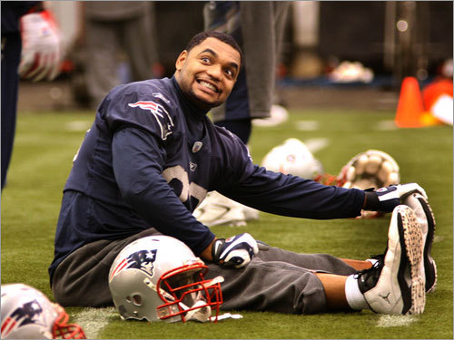 Richard Seymour is all smiles as he stretches out for practice.