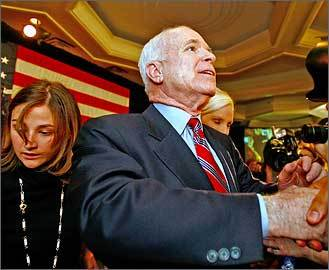 Republican John McCain greets supporters after his victory speech at the Crowne Plaza hotel in Nashua.
