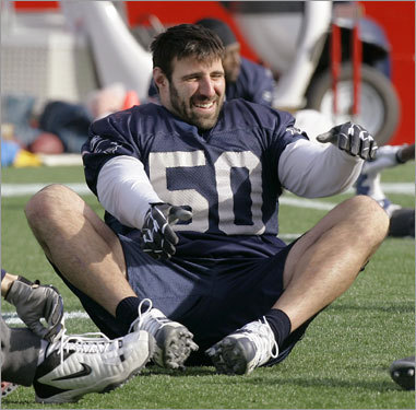 Mike Vrabel works on loosening up before practice, Thurs., Jan 10.