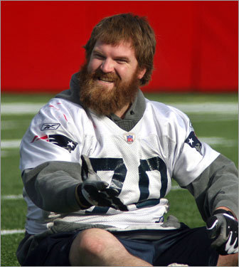 Logan Mankins wears a big grin to match his big beard during stretching at GIllette Stadium.