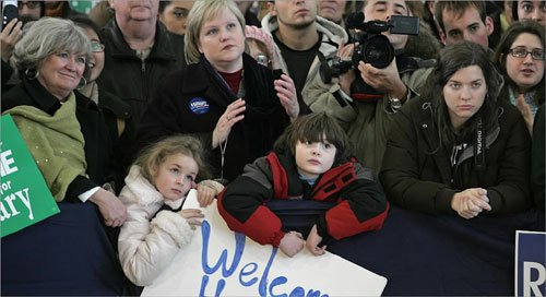 Supporters listened intently as Hillary Clinton (not pictured) delivered a rally speech at the Nashua Airport on Jan. 4.