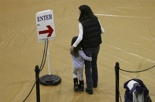 The youth vote came out strong as Katie Friberg (right) took her 3½-year-old daughter, Brooke, to the polls at Hopkinton High School in Hopkinton, N.H. 'She's very interested in the process,' said Friberg of her daughter.