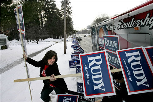 Hailey Wierzbicki of New Jersey struggled to remove signs for Rudy Giuliani from his campaign bus. Wierzbicki planted the signs outside the polls at Brookside Congregational Church on Elm Street in Manchester, N.H.