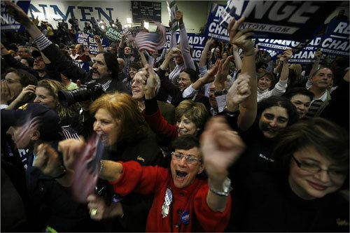 Ann R. Yerman (at center with red sweater) of Scarsdale, N.Y., was one of many supporters who went wild after Senator Clinton's upset victory was officially announced at Southern New Hampshire University.