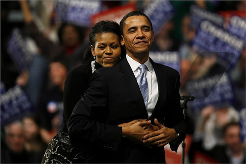 Senator Barack Obama of Illinois received an embrace from his wife, Michelle, at Nashua South High School in Nashua, N.H., after losing the New Hampshire primary to Hillary Clinton.