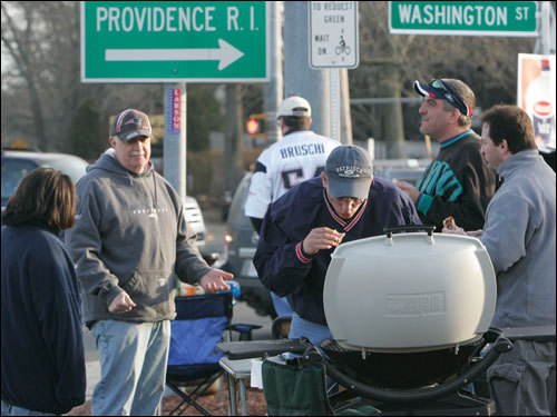 Bob Croak (center) of Wilmington, cooked in the McDonald's parking lot along Route 1 before the New England Patriots play against the Jacksonville Jaguars in the divisional round of the AFC Playoffs.