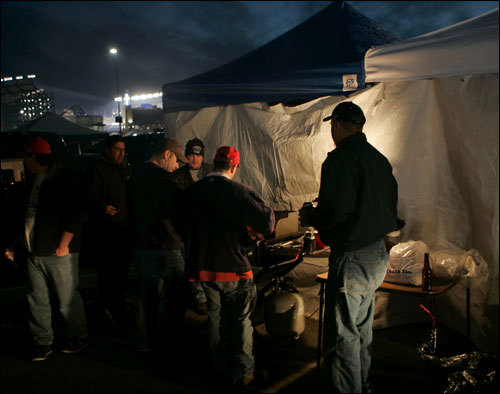 Patriots fans cooked in the parking lot prior to the game.