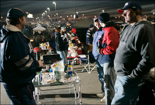 Tailgaters assembled in the Gillette Stadium parking lot before the start of the game.