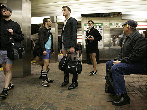 These men without pants took part in a large-scale improv event: 'No Pants 2k8'. An unidentified man (on the right) waiting for the T at the Park Street station chose to watch rather than drop his drawers.