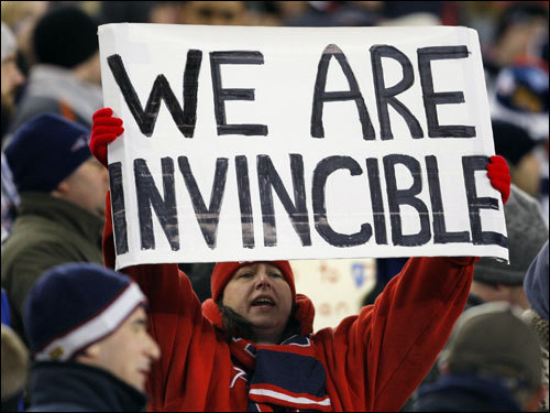 A Patriot fan held up a sign during the game.