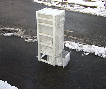 Plastic storage unit Well, it's tall, so it's not hard to miss if you're thinking of parking where it sits. Bonus: the bottom drawer opens up -- for extra stability.