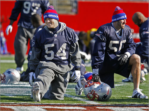 Patriots players Tedy Bruschi (left) and Mike Vrabel had some fun with their matching hats Friday. They were at an afternoon practice session to prepare for Sunday's AFC Championship game against the San Diego Chargers.