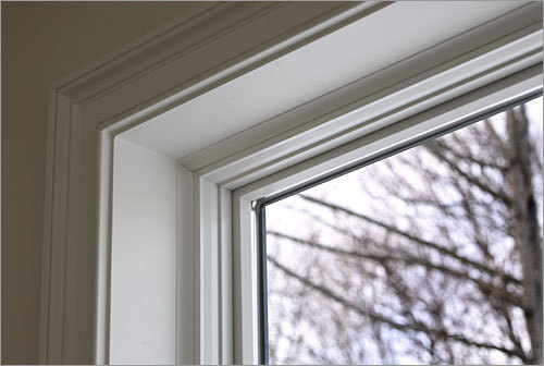 Aluminum-clad wood windows by Pella are installed in 8-inch-deep exterior walls.