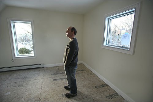 John Rossi, PowerHouse architect and design principal, stands on the third floor. The house has only 7 feet of hallway, 3 percent of the total space, compared with 12 percent to 15 percent of circulation space in a typical home.
