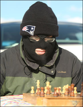 Avid chess player Mike McDermott, of Greenville, NC, tried to concentrate on the game while tailgating.