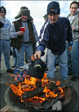 Dennis Carrafiello, of Waltham, burned a San Diego Chargers hat in a fire pit.
